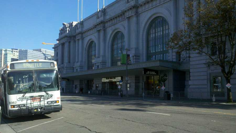 San Francisco city buses and dump trucks are lined up as security across the street from the Civic Auditorium (Oct. 8, 2012).