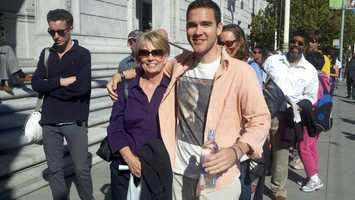 Jan Barnett and her son, Alex Barnett, of Davis, wait in line at the Obama event (Oct. 8, 2012).