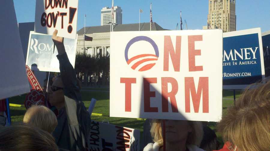 """A Mitt Romney supporter holds a sign saying """"One Term"""" (Oct. 8, 2012)."""