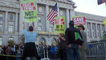 Pro marijuana supporters demonstrate outside Obama's fundraiser (Oct. 8, 2012).