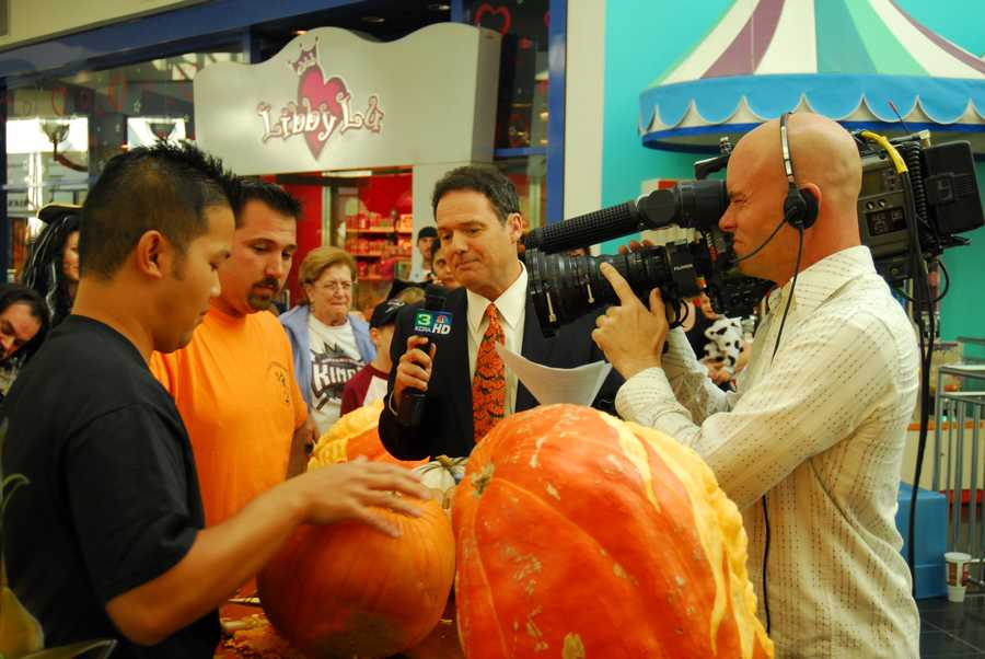 Walt sizing up carved pumpkins during the Noon newscast at the Arden Fair Mall.