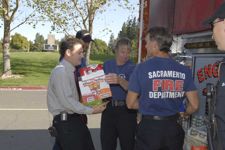 Walt and members of the Sacramento Fire Department load up donations during a Kids Can Food Drive.