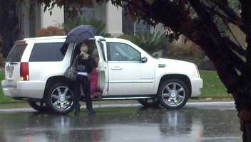 A woman holds an umbrella in Rocklin, as the valley was hit with plenty of showers.