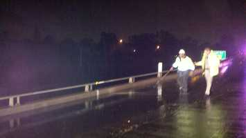 Parts of Interstate 80 flood during a downpour Monday.