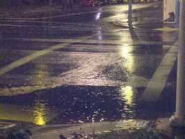 A corner floods in downtown Sacramento during adownpourof rain early Monday morning.