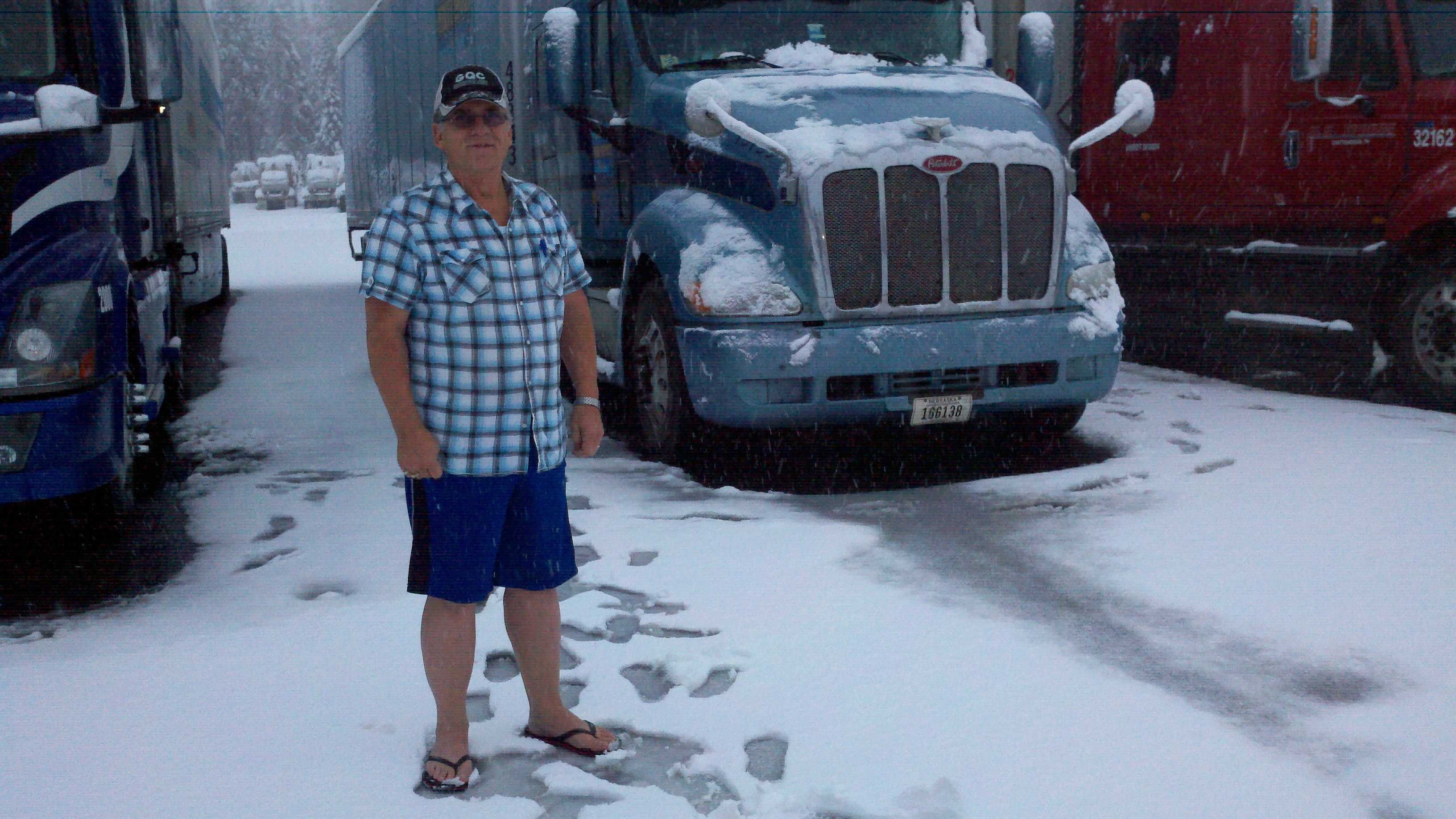 Brent Garrett stands in front of his big rig in Nyack, Calif.