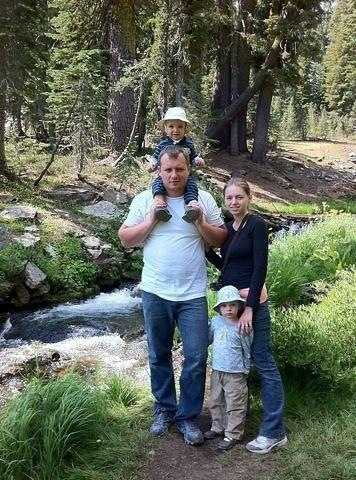 Denis Bukhantsov is pictured with his children and wife, Alina. His wife and two of his kids were killed Tuesday. His brother, 19-year-old Grigoriy Bukhantsov, was arrested Wednesday morning on suspicion of the killings.