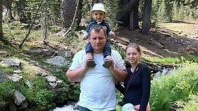 Denis and Alina Bukhantsov pose with two of their children. More photos