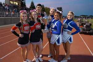 Cheerleaders from both Bella Vista and Del Campo present the KCRA 3 Red Ribbon Game of the Week Trophy (Provided by Wilson Trophy).  The Red Ribbon campaign encourages responsible behavior and communicates the importance of a drug free life.
