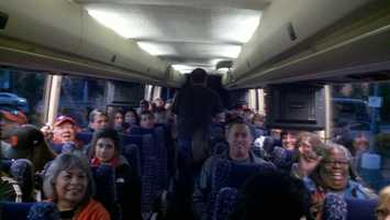 Orange-and-black clad fans fill a bus Wednesday right before a Halloween Day parade celebrating the 2012 World Series champion Giants.