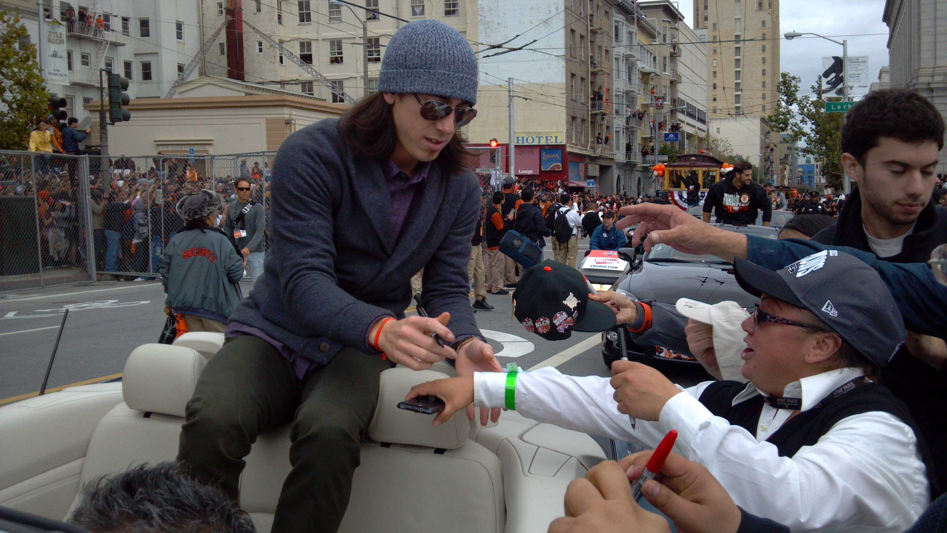 Tim Lincecum signs autographs during a parade Wednesday.