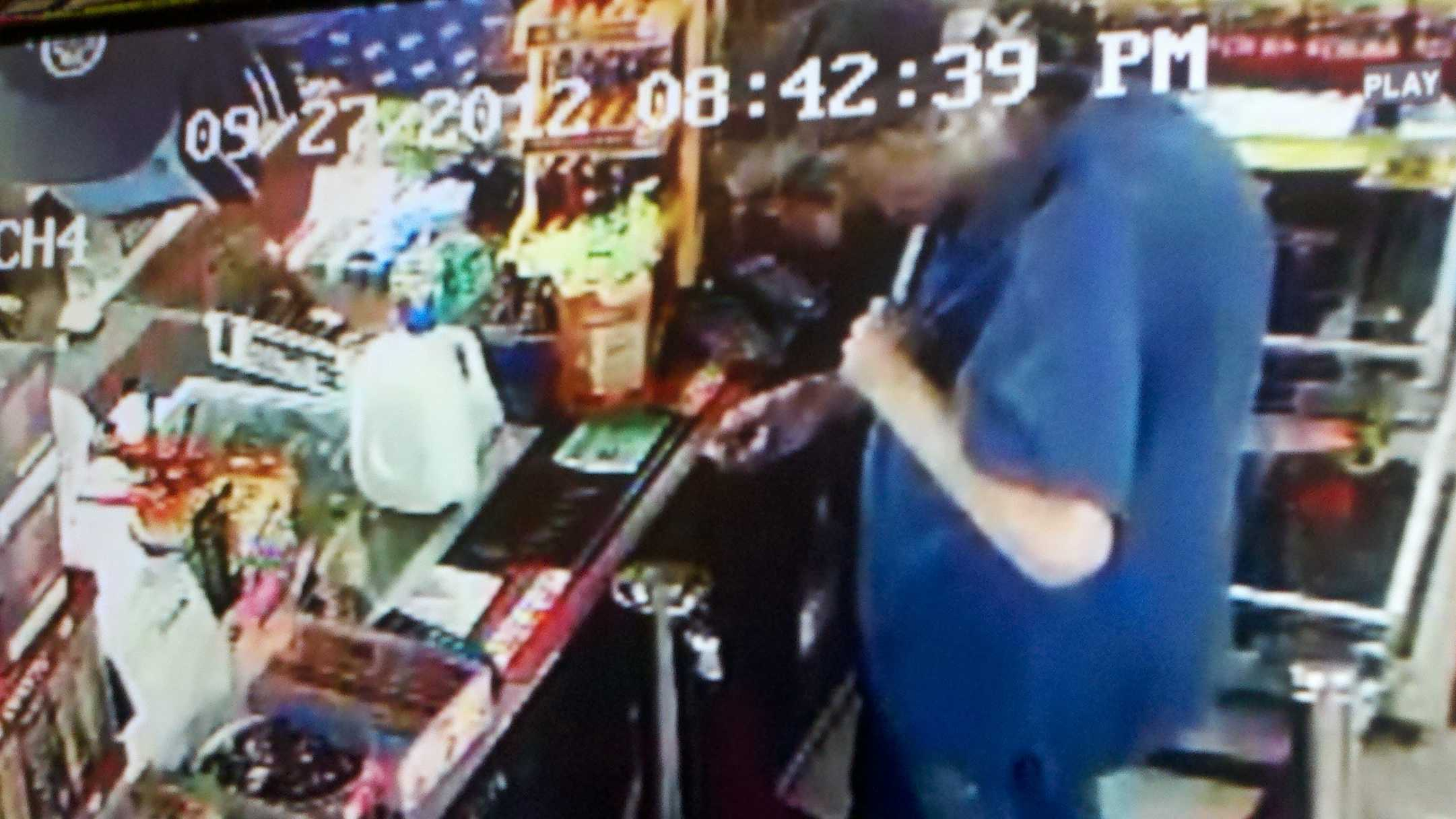 A surveillance camera captured this image of Philip Jensen buying milk minutes before he was hit and killed along Fulton avenue.