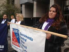 Raley's workers, including Doreen Martinez of Watsonville, rally to try and keep annual pay raises and premium pay for working holidays and Sundays.