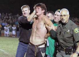 A YouTube video swept the Internet, showing an off-duty lieutenant tackling a shirtless man who graced the Colfax football field in a strange incident.