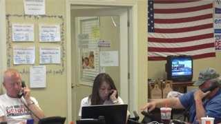Volunteers for Jeff Denham call voters at the candidate's campaign headquarters.