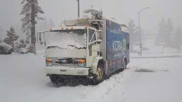 The KCRA live truck is covered with snow on Thursday.