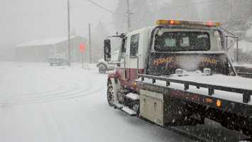 A tow truck in Nyack is parked as snow begins to fall on Thursday.
