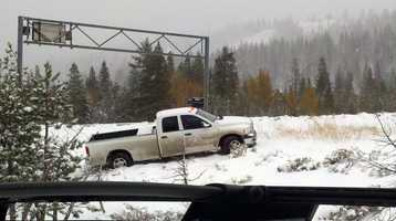 A truck spins out Friday as a November storm continues to bring cold weather, rain and snow into the area.