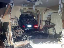 A woman was injured Friday after she plowed through the front door of a home in Folsom, police said.