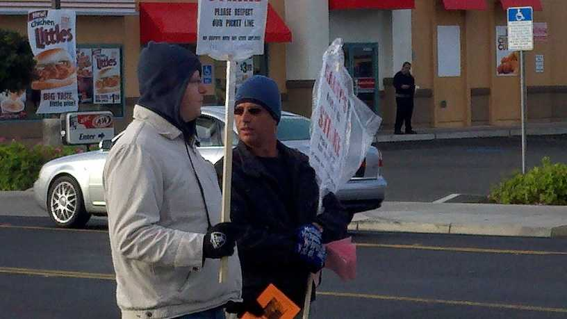 Jerry Gray and Joe Henter got word of a labor agreement as they held signs along West Capitol Avenue.