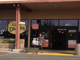 Shoppers walk in and out of the West Sacramento Raley's, where the pickets had stopped.