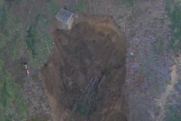 The break early this morning unleashed tens of thousands of gallons of water from a city-owned reservoir.