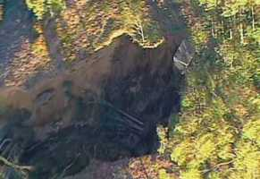 Thousands of gallons of water and mud gushed down a hillside.
