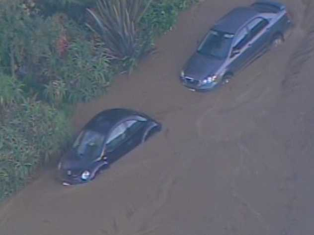 Vehicles are covered in mud.