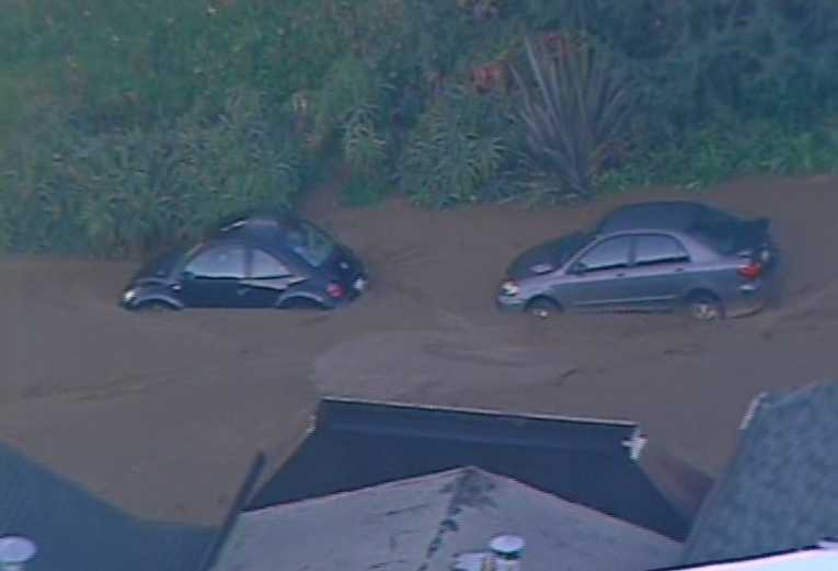 Cars are buried up to the wheel wells.
