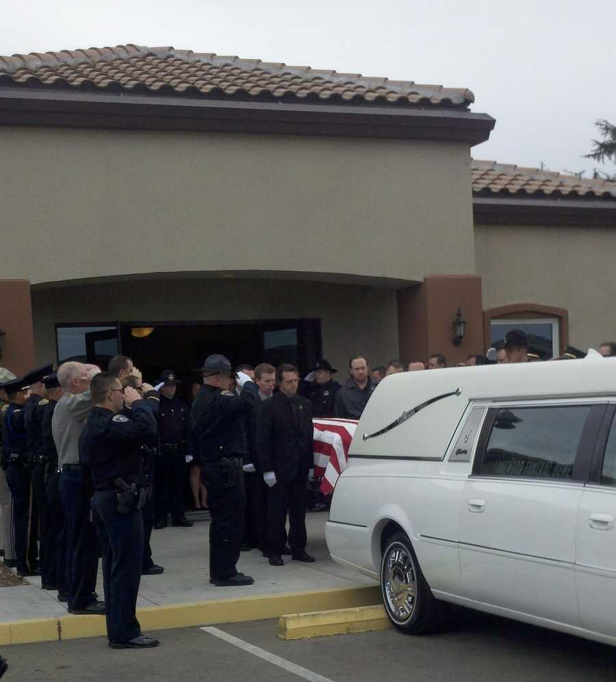 Oakdale Police Officer Paul Katuszonek is remembered during a service.