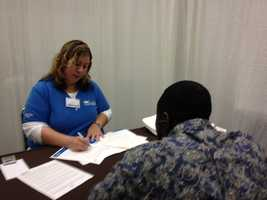 A loan adviser meets with a home buyer at the Sacramento Convention Center to review his application for a $15,000 grant toward a down payment on a new home.