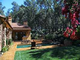 The home has attached guest quarters and a resort-style yard.