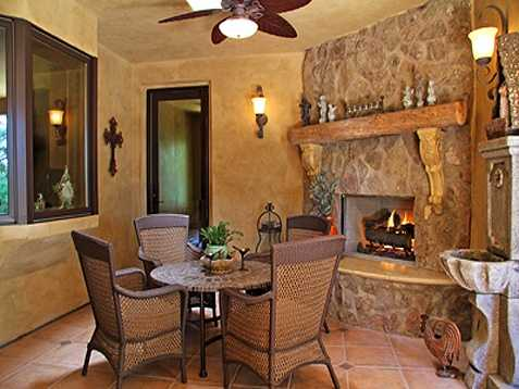 This dining area is accented by a handsome fireplace.