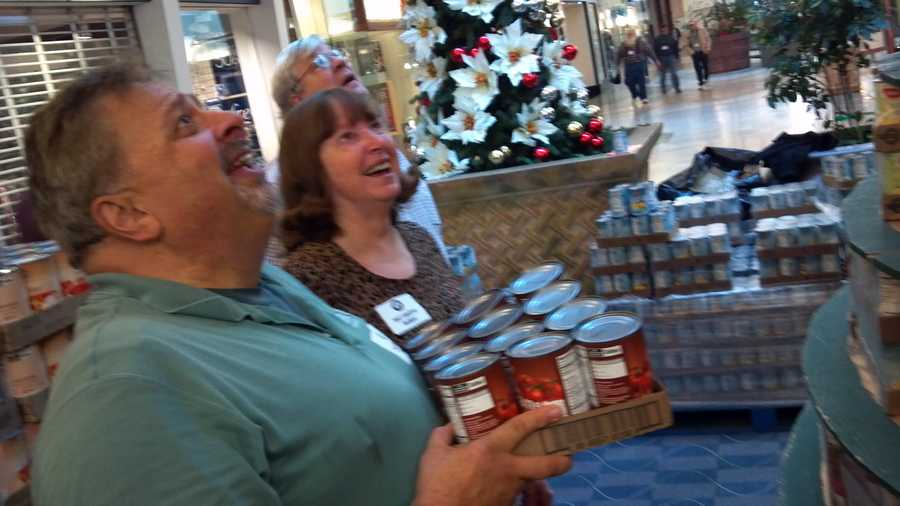It's quite the sight at Sunrise Mall: 18,000 cans stacked nearly 15 feet in the shape of a Christmas tree. The annual fundraising drive will benefit the Salvation Army. Each year, two trees of can foods are built. Last year, the group raised $72,000 as well.