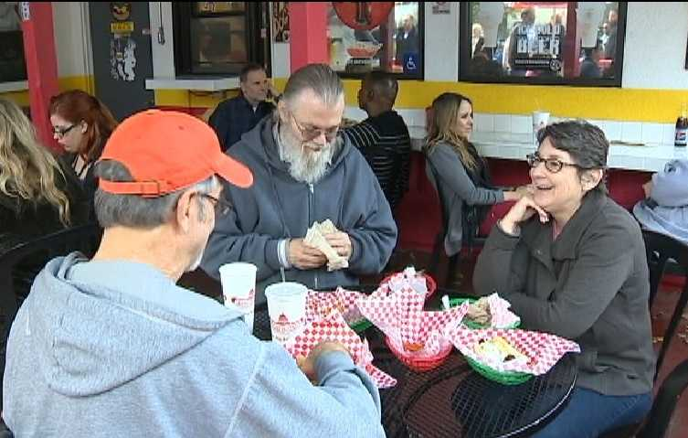 Patrons enjoy their hot dog lunches on Tuesday.