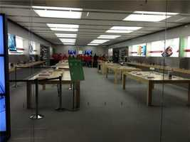 """Rumor had it Apple's first 25 customers """"will be very pleased"""" with a free gift. Some even paid for a place in line. Were they disappointed?"""