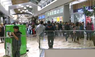Shoppers make their way into the Roseville Galleria.