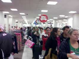 Black Friday shoppers encounter long lines at the register.