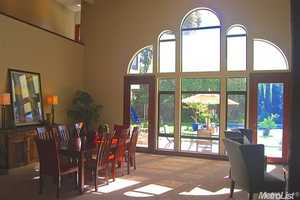 Plenty of light enters the dining area, which has views of the pool in the backyard.