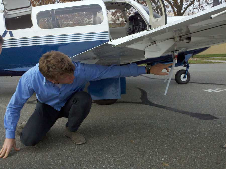 Scientists use a laptop to read the airborne 'sniffer' that is capable of detecting gas in the air.