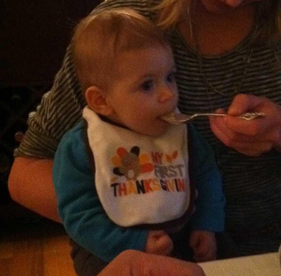 Hazel enjoying her first Thanksgiving meal.