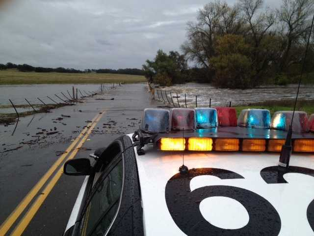 FridayScott Road is partially blocked by water.