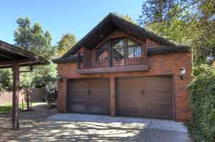 This wonderful brick home also has a guest house and newly built two-car garage.