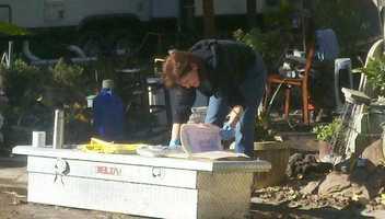 Sue Housch picks through flood-damaged belongings at Auburn Villa Park near Citrus Heights.