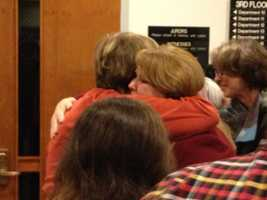 Assistant District Attorney Dawn Bladet hugs one of the victims' family members after the jury recommended death for Richard Hirschfield.