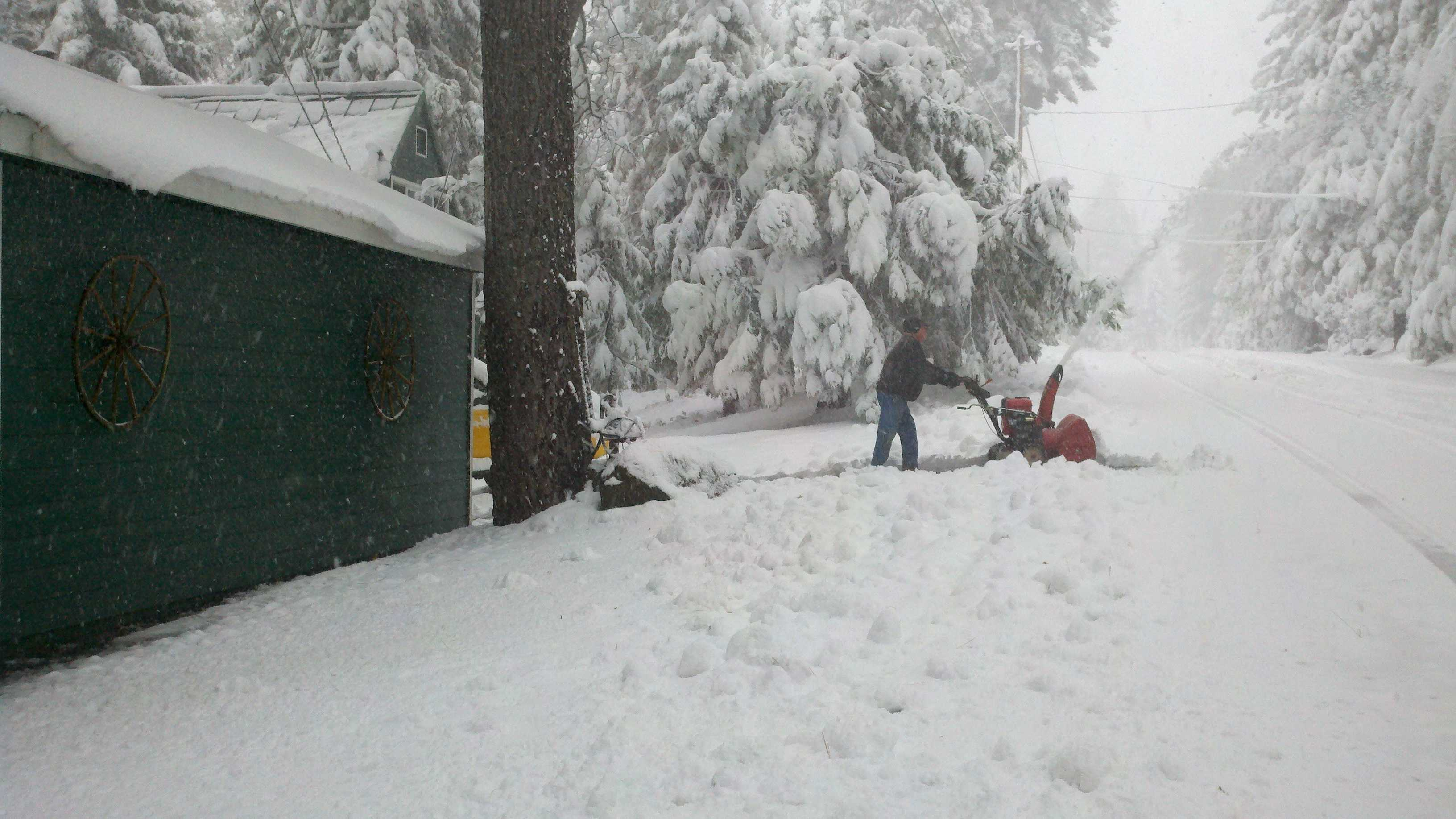 A resident in Blue Canyon clears snow early in the season.