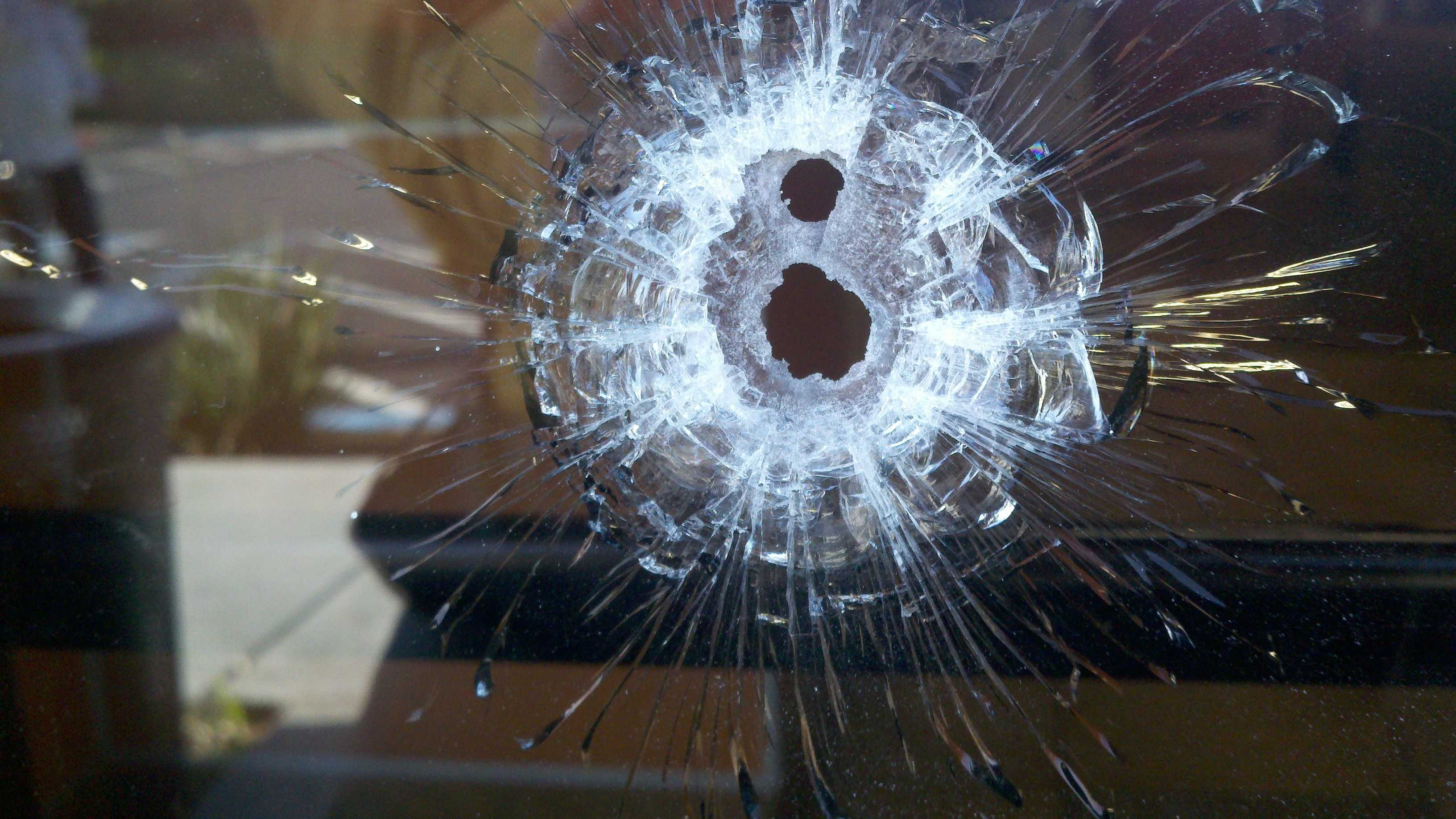 A bullet pierced a glass door at the Jack in the Box.