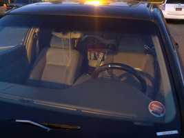 A car seat inside the vehicle struck by bullets during a shooting outside a store in Sacramento.