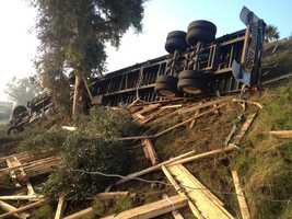 An overturned big rig spilled lumber across the northbound lanes of Highway 99 on Tuesday, slowing the morning commute.