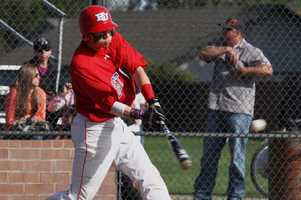 East Union High School baseball player taking a swing